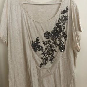 Cream colored t-shirt with beaded floral design